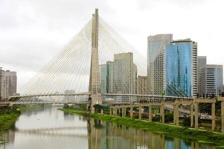 Sao Paulo city landmark Estaiada Bridge reflex in Pinheiros river, Sao Paulo, Brazil Banco de Imagens