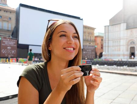 Happy smiling woman with cup of coffee on sunny italian landscape