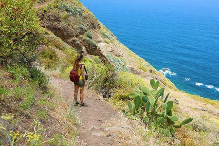 Traveler hiker woman enjoying landscape in Tenerife, Spain. Natural tourism backpacker trekking adventure concept.