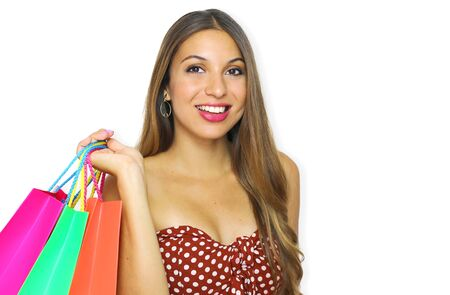 Brazilian smiling beautiful fashion girl with shopping bags looking at camera on white background. Close up studio portrait. Copy space.