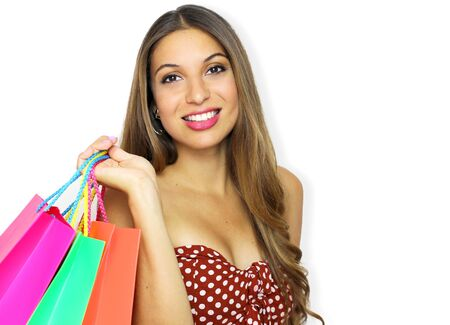 Portrait of smiling beautiful fashion girl with shopping bags looking at camera on white background. Copy space. 写真素材