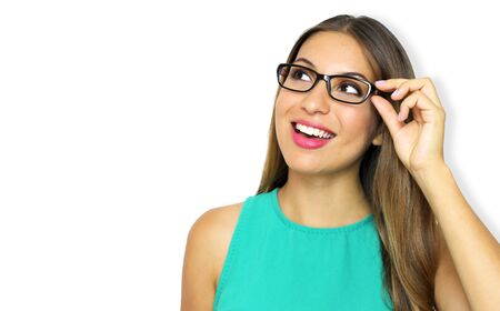 Excited young woman with glasses looking to the side the copy space. Female business woman isolated on violet background.