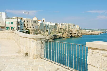 Scenic view from terrace of Mediterranean sea and cliffs of Polignano a Mare town, Apulia, Italy. 写真素材