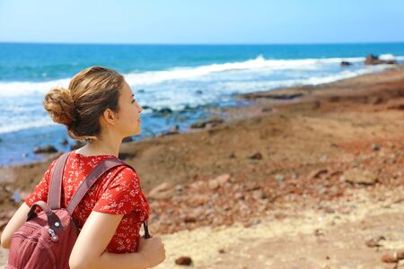 Young backpacker exploring Tenerife Island in her travel vacation on Canary Islands. Copy space.