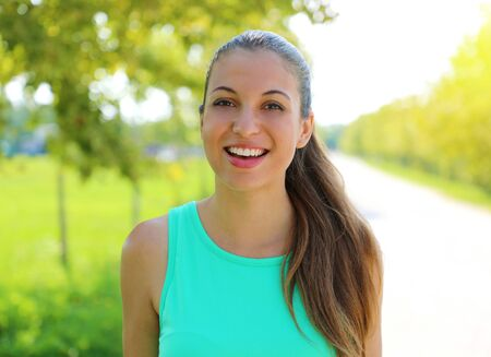Brazilian smiling woman with a perfect white smile outdoor in the park. 写真素材