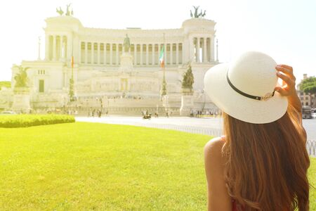 Travel in Rome. Back view of beautiful girl visiting Venice square famous landmark of Rome. Summer holidays in Italy. Stock Photo