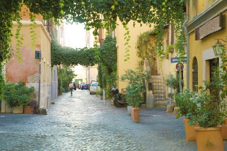 Trastevere in Rome, Italy. Cozy old street in Trastevere neighborhood of Rome, on the west bank of the Tiber, architecture and landmark of the city of Rome.