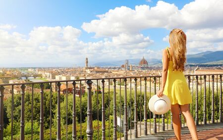 Attractive woman in Florence birthplace of the Renaissance. Full length view of pretty girl enjoying panoramic view of Florence city in Tuscany, Italy.