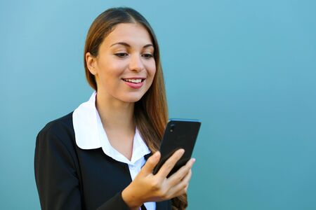 Young business woman chatting with mobile phone outdoors. Copy space.
