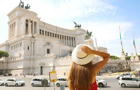 Visiting the city of Rome. Back view of beautiful girl visiting Altar of the Fatherland famous landmark of Rome. Summer holidays in Italy.