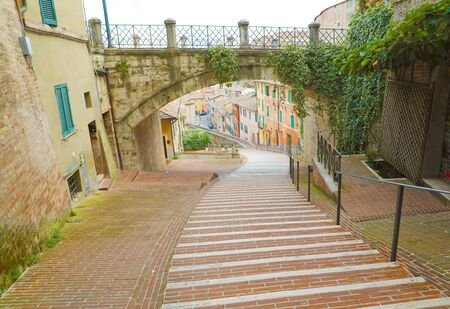 Panoramic view of the historic aqueduct forming Via dell Acquedotto pedestrian street along the ancient Via Appia street in Perugia historic quarter, Italy.