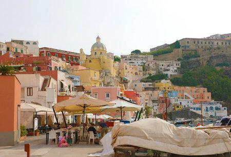 PROCIDA, ITALY - SEPTEMBER 19, 2019: Beautiful colorful village of Procida island, Naples, Italy. Редакционное