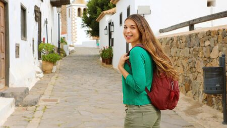 Young backpacker girl visits small colonial village of Betancuria, Canary Islands, Spain Reklamní fotografie