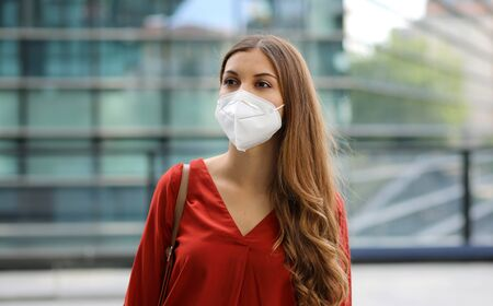 Sense of bewilderment. Young woman in empty city street wearing protective mask. Girl with face mask feeling alone during a pandemic. Stock fotó