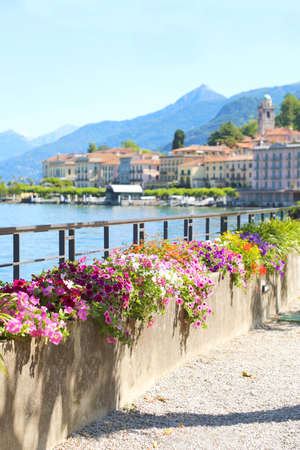 Walk along the Lake Como in Bellagio in summer time, Italy