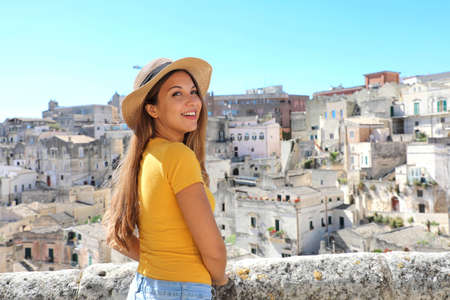 Happy cheerful tourist girl visiting Matera, Italy