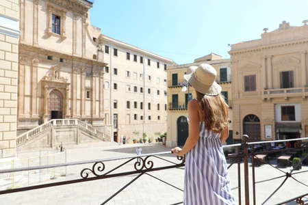 Young tourist woman visiting the old town of Palermo in Sicily, Italy