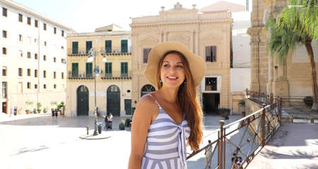 Beautiful smiling tourist woman visiting the old town of Palermo in Sicily, Italy Archivio Fotografico