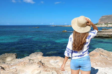 Beautiful traveler girl in Sicily. Young woman enjoying holidays in Favignana Island in Italy.