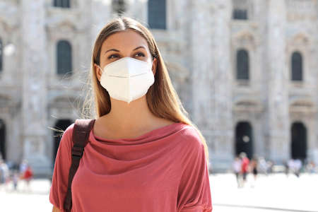 COVID-19 Young business woman wearing KN95 FFP2 face mask protective for spreading of Coronavirus in Milan, Italy Archivio Fotografico