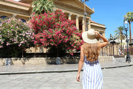 Travel in Sicily. Back view of beautiful woman visiting Palermo, Italy.