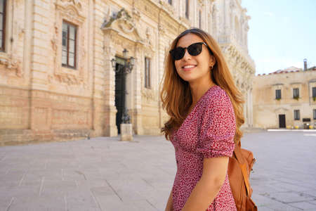 Culture and Young People. Beautiful trendy girl visiting the baroque city of Lecce, Apulia, Italy. Archivio Fotografico