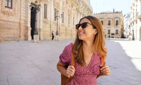 Culture and Young People. Pretty young woman visiting the baroque city of Lecce, Apulia, Italy.