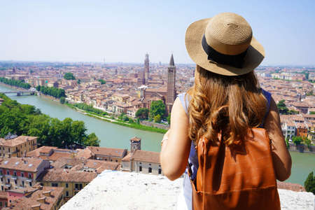 Traveler girl in Verona, Italy. Backpacker enjoying visiting Europe. Young tourist people traveling alone.