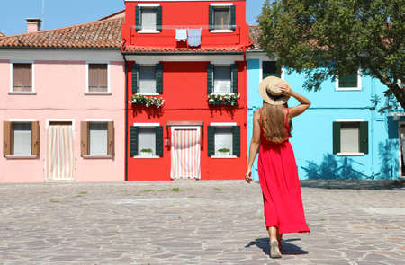 Holidays in Venice, Italy. Attractive girl strolling in Burano village, Venice, Italy.