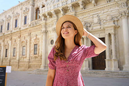 Fashionable young woman visiting the city of Lecce in Italy in her cultural tour in Europe