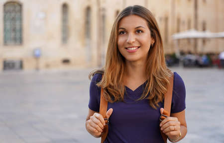 Beautiful traveler girl goes on a cultural trip to the historic cities