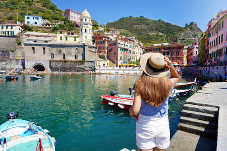 Young female tourist in the picturesque town of Vernazza, Cinque Terre, Italy