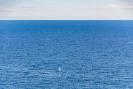villefranche sur mer: Sailing boat in front of Monte Carlo