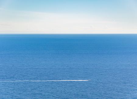 villefranche sur mer: Boat in the mediterranean sea in front of Monte Carlo