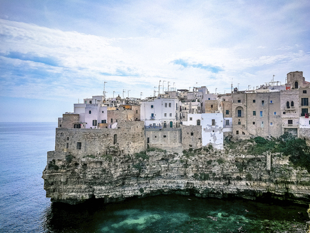 Polignano a Mare typical houses on the bay beach in Salento Italy