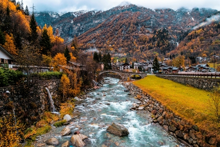 Lys river in a forest in the valley of Gressoney near Monte Rosa during autumn 写真素材 - 117292501