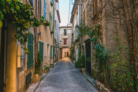 Little alley in the medieval village of Antibes in a sunny winter day