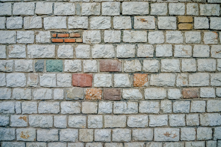 Wall of white bricks and other colors