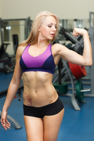 Strong sporty girl showing her biceps Stock Photo - 19379404