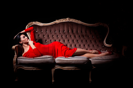Beautiful woman in elegant dress in luxury interior
