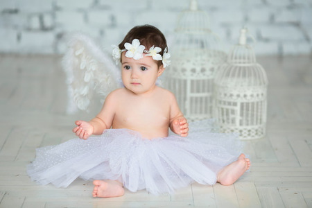 Little baby girl with angel wings