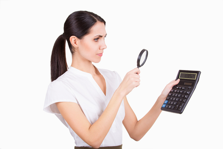 Young business woman calculating finance and looking in loupe isolated