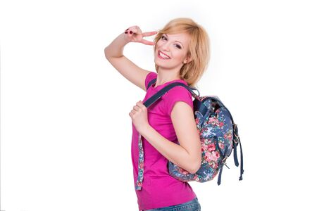 cheerfull: Happy student girl with backpack smiling and making cheerfull gesture. Isolated on white