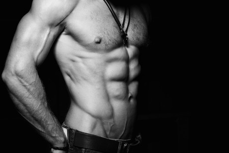 nude abs: Muscular and sexy torso of young man with perfect abs. Black and white photo