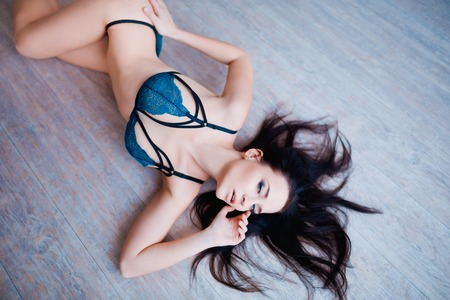 breasts erotic: Perfect, sexy body, belly and breast of young woman wearing seductive lingerie. Beautiful hot female in underware posing in sensual way. Stock Photo