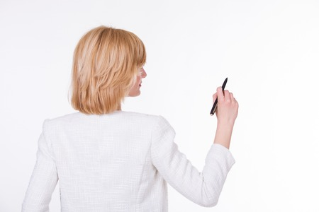 economic forecast: Portrait of young beautiful woman holding a pen on white background. Writing concept