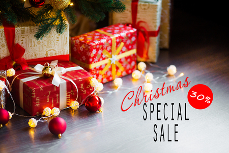 Sales on Christmas and New Year holidays. Festive decoration with informative inscription of 30 percent discount for shop-windows, shopping malls and advertizing background concept
