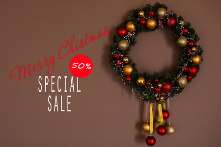 Sales on Christmas and New Year holidays. Festive decoration with informative inscription of 50 percent discount for shop-windows, shopping malls and advertizing background concept