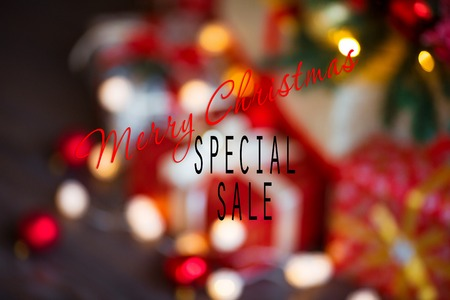 Sales on Christmas and New Year holidays. Blurred Festive decoration with informative inscription of discount for shop-windows, shopping malls and advertizing background concept.