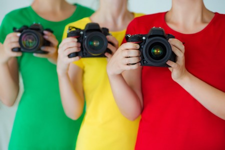 Group of people holding photocamera. Concept of hobby and study in photo school